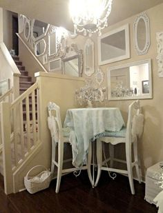 White shabby chic decor. Personally I would add a few more touches of color  but overall I love the idea! love the mirrors!