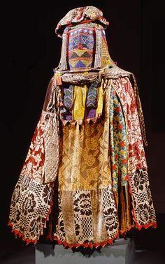 Egungun Masquerade Dance Costume: Ekuu Egungun Early 20th century Yoruba peoples, Oyo region, Nigeria Cloth, metallic thread, glass beads, cowrie shells