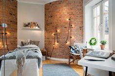 Exposed brick wallpaper - Dinah would love this for her room! Lights, too.