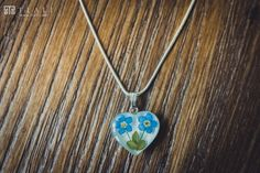 Symbol of remembrance and enduring love, the lovely heart two forget-me-not pendant. http://tlali.com/products/forget-me-not-jewelry-two-flower-heart-pendant