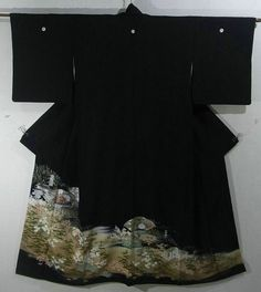 This is a graceful Kurotomesode Kimono with a design of seasonal flowers such as 'botan'(peony), camellia and 'tachibana'(Japanese green citrus) on fan, which is dyed
