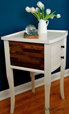 An easy DIY nightstand makeover using paint sticks, nightstand redo, stain and wood glue to give it a rustic look.