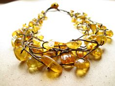 Baltic Amber Necklace - Natural Honey Amber Jewelry -  Sunny Yellow Bee Brown Cord - Multi Strand Necklace. $60.00, via Etsy.