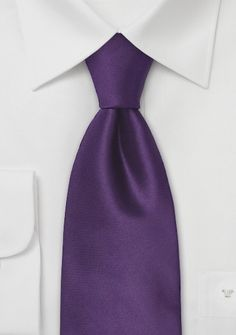black and white suits for the boys with deep purple silk ties on the top and kilts on the bottom