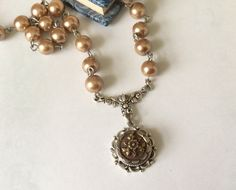 Botanical Button Necklace , Victorian Pendant ,  Brass Flower Button Jewelry , Taupe Pearl Chain ,  Up cycled Jewelry by VintageRedo by VintageRedo on Etsy https://www.etsy.com/listing/224594101/botanical-button-necklace-victorian