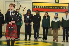 The curling team participated in a traditional Curling Bonspiel, during which a Scottish bag-piper pipes all of the players out on to the ice before the final match.