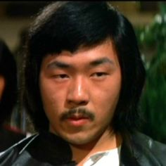 Wang Lung Wei, aka Johnny Wang, China (1949) is a Chinese actor, director, producer, and action choreographer, who has starred in over 80 kung fu films, mainly for Shaw Brothers Studios. Some are Five Deadly Venoms,  Master of the Flying Guillotine, Ten Tigers of Kwangtung and many more since 1974