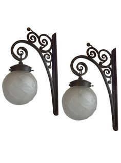 Unusual French Art Deco hand hammered wrought iron lantern sconces with Mueller glass shades.  || TheHighBoy || #highboystyle #antiquesmakeitbetter #antiques #vintage #sconces
