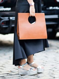 Modern structured handbag + chunky metallic platform sandals