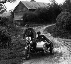 ISDT 1950, Wales - Harold Tozer and Jack Wilkes  travelling down a mudy lane on their sidecar