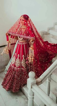 For all the brides of today, these trending bridal poses will make sure that you are captured beautifully in your elegant bridal ensemble. wedding jewelry A guide on how to slay your bridal poses this wedding season Wedding Lehenga Designs, Designer Bridal Lehenga, Indian Bridal Lehenga, Indian Bridal Outfits, Indian Bridal Fashion, Indian Bridal Wear, Wedding Lehnga, Punjabi Wedding, Bridal Lenghas