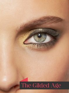 Gold eyeshadow on the inner corner and below lower lash; brown cream shadow to the middle of the lid, then black eyeshadow, blending out toward the outer corner.
