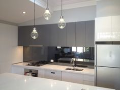 Mirror splash back with modern grey and white.