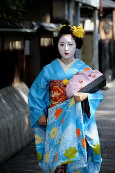 """Maiko Mamemaru (apprentice geisha). Geisha translates to """"a person of the arts."""" For nearly 400 years, the life of a geisha was highly coveted for Japanese women. To become a geisha often meant years of intense training—sometimes from childhood—in the quest for artistic beauty in music, dancing, tea ceremony and conversation. The gokagai of Kyoto are its five geisha districts, also known as """"flower towns"""". Gion Kōbu, Pontochō and Kamishichiken have the highest status, entertaining…"""