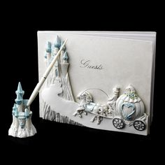 This splendid and majestic guest book will bring a smile to everyone's face! This wonderful guestbook features a darling accent on the cover of Cinderella's pumpkin carriage riding up to the enchanted castle in glittering white and light blue. This book contains 50 pages and has 1000 lines for guest's signatures, thoughts or wishes and comes with a matching pen set.  #Wedding guest books, #unique wedding guest books, #wedding guest book ideas, #wedding guest book sets, #timelesstreasure