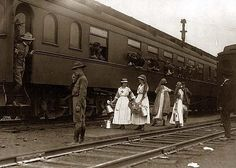 Troop Trains - World War I Soldiers on Train, with Red Cross workers in front, probably in Washington, D.C.