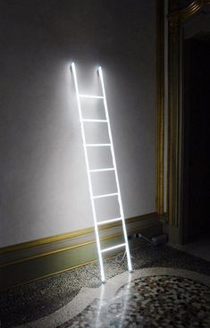 Amazing design lamp made byMassimo Uberti's, Ladder shape with neon, it should be considered as an artistical light sculpture but it would be nice in your living-room! #Concept #Floorlamp #Lamp #Lighting #Lightingdesign #Modernlighting #Sconce