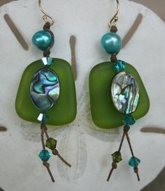 Bottle green seaglass earrings--accented witha large aqua pearl, a paua oval, Swarovski crystals, and gold filled findingd
