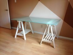 """IKEA Glass desk top with adjustable white trestle legs. IKEA GLASHOLM glass table top (58 1/4x28 3/4 """") + pair of FINNVARD trestle legs with shelf, white. The table top has no design, it is plain frosted look. The tempered glass is stain resistant and easy to clean see: http://www.ikea.com/ca/en/catalog/products/S59002021/ Pick up only: H1x3k2 near Rachel and St-Michel blvd. Asking 100$"""