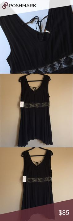 NWT Free People Little Black Dress w/ Lace Size Lg Very beautiful, flowy black dress from Free People. There is a band of lace across the waist. Retails for $128  Ruched detailing at shoulders Front and back V-neckline Ties at base of neck Lace detailing Side pockets Lined 100% Rayon Free People Dresses Midi