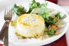 Twice-baked goat's cheese souffles with pear, hazelnut and rocket salad