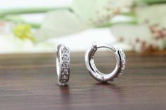 Items similar to White Gold Diamond Accent Huggie Hoop Earrings, Diamond Hoop Earrings, Baby Earrings, Dainty Huggie Earrings, XS Tiny Hoops Earrings on Etsy Baby Earrings, Diamond Hoop Earrings, Stud Earrings, Diamond Bands, Diamond Wedding Bands, Diamond Stud, White Gold Diamonds, Colored Diamonds, Engagement Ring Shapes