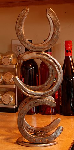 horseshoe wine bottle holder - hmmm, hubby needs a new project...
