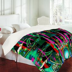 Turn your basic, boring down comforter into the super stylish focal point of your bedroom with this Randi Antonsen Emerald Forest duvet cover! Custom printed when you order it, this duvet cover is not only personal, but incredibly cozy as well. Created out of microfiber material that is unique to DENY Designs, our duvets are ultra soft and amazingly comfortable. This Randi Antonsen Emerald Forest duvet cover will make getting out of bed in the morning just a little bit harder!