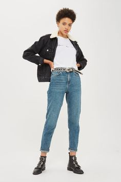 The fashionable appeal of our mom jeans continues into the new season. Featuring a high rise and tapered leg, the authentic blue rigid denim also features rolled hems. We're going for double denim and styling it with a dark indigo coat and studded ankle boots for retro-style look.