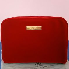 Gucci cosmetic bag Never been used.. still in plastic bag..70% polyester,  30% nylon.. Gucci Bags Cosmetic Bags & Cases