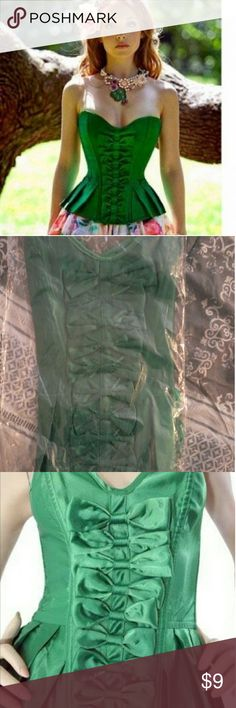 Green bow corset top Green,multi bow, corset top. Lace up back. Sized as a large BUT FITS AS A SMALL. This item fits tighter than a large because it came from China and their sizing is different. It is brand new w/o tags and has never been worn. Other