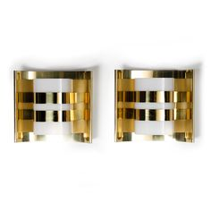 Hans-Agne Jakobsson wall sconces in brass and plastic.