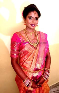 Traditional, Southern Indian bride, Chaitra wears bridal silk saree and jewellery for her Reception. Makeup and hairstyle by Vejetha for Swank Studio. #BridalSareeBlouse #SariBlouseDesign  Pink silk kanchipuram sari or saree. Tamil bride. Telugu bride. Kannada bride. Hindu bride. Malayalee bride  Find us at https://www.facebook.com/SwankStudioBangalore