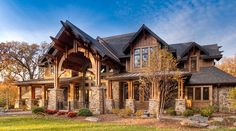 """We've explored some fantastic entrance design in recent posts but this home has something unique. The entrance of the home has almost a battle-like, aggressive feature to it. The interior is a blend of beautiful, warm exposed timber beans and subtle rock pillars. Very nice. Source:http://www.stillwaterarchitecture.com/GalleryofHomes/WesternTimberLog/BurrRidgeResidence.aspx Related posts: Modern Timber Frame Cottage Rustic """"Barn""""Read More"""