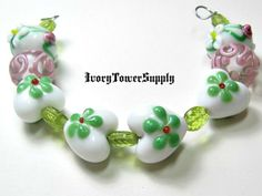 White and Green Lampwork Heart Set PA. Starting at $5 on Tophatter.com! http://tophatter.com/auctions/41233-designer-style-supplies