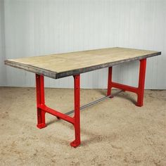 reclaimed industrial table. these are almost the exact legs that we picked out, just not in red obviously