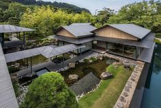 Esteemed architect Kengo Kuma achieves an abstraction of modern and traditional Japanese form in this seaside home. Built on volcanically formed coastline cliff just outside of Tokyo, Kuma recalls…More 4 8 8 9 9 Architecture Du Japon, Modern Japanese Architecture, Japanese Home Design, Japanese Style House, Traditional Japanese House, Tropical Architecture, Japanese Interior, Chinese Architecture, Architecture Design