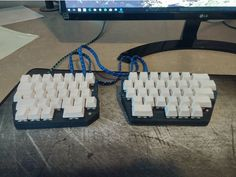 This is my first ever custom designed and wired keyboard. It was a very fun project that took far longer than I had predicted to design and cost more than I care to admit. I'm actually currently typing on it right now and have been using it for more than a month. The two sides are connected by two ethernet jacks, which is not the most attractive solution, but I wanted to avoid putting a board in each side and struggle to figure out how the whole thing works. It is assembled using 8 M3x12 ...