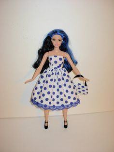 Here is a wardrobe that any girl would want for her new Barbie curvy collection.  New white with blue polka dots print strapless dress with blue
