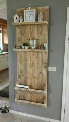 Wood plank wall organizer with slant pockets and shelves
