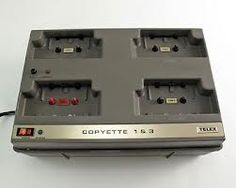 Small high-speed desktop cassette duplicators like this Telex Copyette 1 & 3 duplicated from a master cassette tape onto three blank cassettes simultaneously. They were popular with small studios, churches, schools and businesses. Most were monaural like this one, but a few were stereo. Frequency response was only 50 - 10,000 Hz and signal-to-noise ratio was only -45 dB or -50 dB, so they were more suited to spoken word tapes and not music. I still have a Wollensak unit similar to this one.