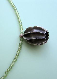 "Necklace ""Seedpod""; blackened Silver and Peridot Beads by Dörte Dietrich"
