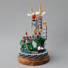 I bought the IKEA HÄRLIGA glass dome for some time ago to build a fantasy MOC for my new work office. But I've had a Builder's Block (Writer's block) for a while now. But then I saw Yang Wang's Build on TBB and I got my inspiration back. Thanx 4 that!  A great thing with this kind of MOC is that you can put it anywhere and it will stay free of dust.