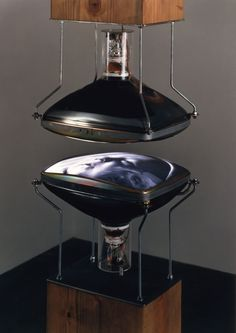 Bill Viola (American), Heaven and Earth, 1992 -exposed tubes of two video monitors are positioned facing each other, separated by a few inches and mounted at the ends of two wood columns -the upper monitor shows the artist's mother on her deathbed and the lower monitor shows the face of his newborn son. Since the glass surface of each monitor reflects the image on the opposing screen, the birth-face and the death-face appear simultaneously as layered reflections within each other's image