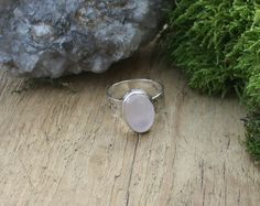 Sterling silver and Rose Quartz stone ring, with the Om symbol stamped around the band.  Rose Quartz is most associated with love, and the