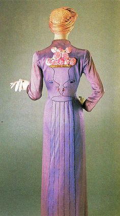 Schiaparelli Coat - 1937 - by Elsa Schiaparelli - The Two-faced design is the work of celebrated artist Jean Cocteau - Photo from Architectural Digest, September 1988