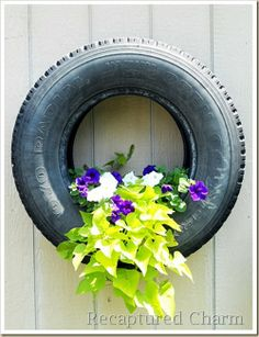 DIY Hanging Tire Planter (Drill hotes in the bottom and affix with strong bolts and nuts. Additional photos via Recaptured Charm blog)