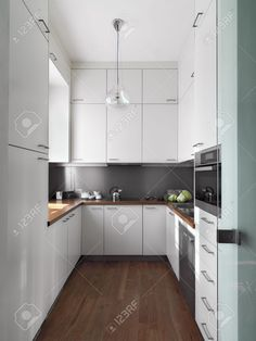 Modern White Kitchen With Wood Floor Stock Photo, Picture And Royalty Free Image. Image 26945357.