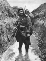 Trenches in World War I. A French Soldier standing in a muddy trench, WWI. (circa 1916) (Photo by Hulton Archive/Getty Images)