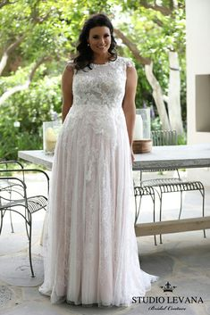 Plus size wedding gown with a shimmering lace and a PINK underlayer! Daisy. Studio Levana